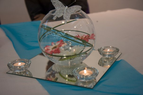Fishbowl with water pearls, flower heads and butterflies